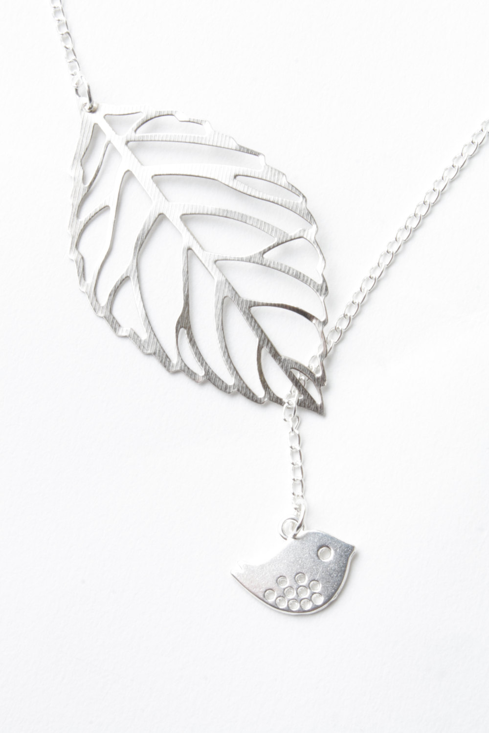 Bird necklace leaf necklace bird and leaf necklace silver bird necklace leaf necklace bird and leaf necklace silver leaf silver bird bird jewelry lariat leaf jewelry delicate necklace aloadofball Image collections